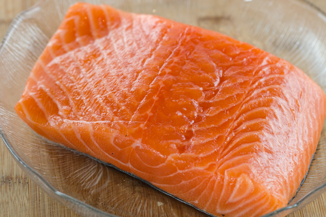 Sprinkle the salmon with kosher salt and a little sugar to bring out the moisture in the fish.