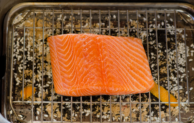 Center the salmon on the rack over the smoking medium.