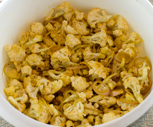 Cauliflower tossed with curry powder. The orange color comes from the turmeric.