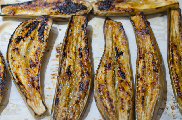 Once the eggplant is soft turn it cut side up. apply the glaze and put the tray under the broiler.