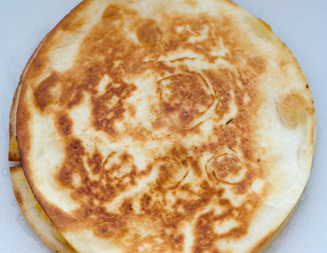 Cook individual tortillas in a non stick pan on both sides until they are golden brown.